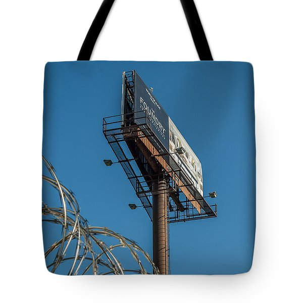 Tote Bag featuring the photograph Out Of Reach by Bernd Laeschke