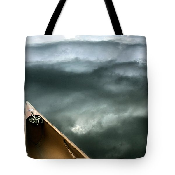 Paddling Before The Storm Tote Bag