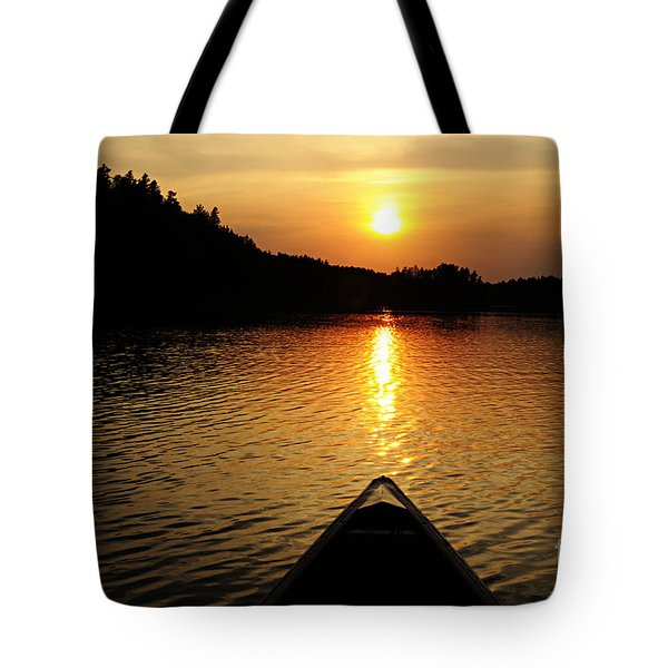 Paddling Off Into The Sunset Tote Bag by Larry Ricker