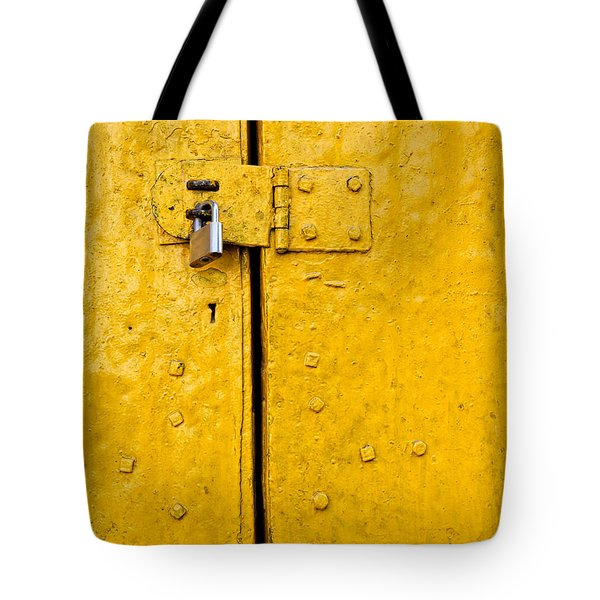 Padlock On An Old Yellow Door Tote Bag