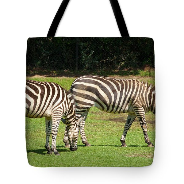 Tote Bag featuring the photograph Pair Of Zebras by Charles Beeler
