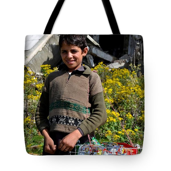 Tote Bag featuring the photograph Pakistani Boy In Front Of Hotel Ruins In Swat Valley by Imran Ahmed
