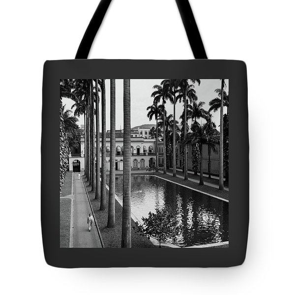 Palm Trees Bordering A Pool Tote Bag