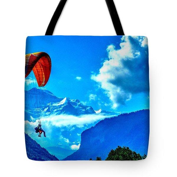 Tote Bag featuring the photograph Parasailing Swiss Alps by Joe  Ng