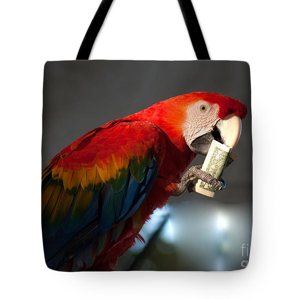 Tote Bag featuring the photograph Parrot Eating 1 Dollar Bank Note by Gunter Nezhoda