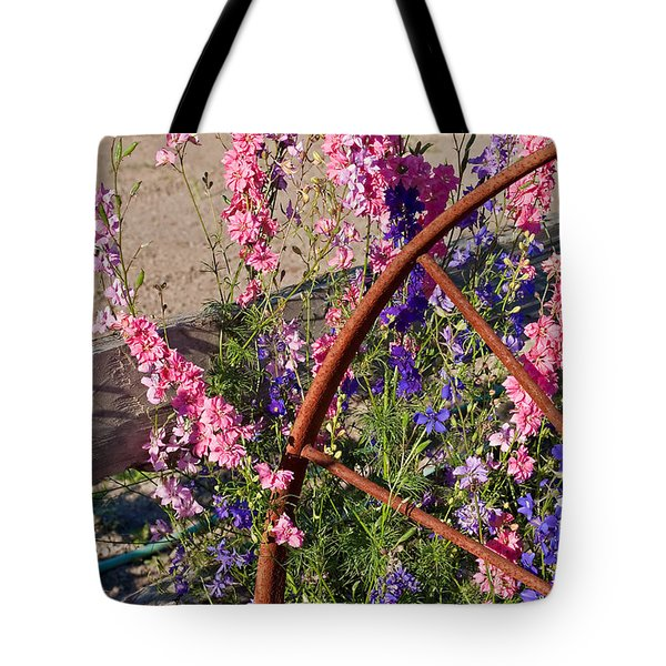 Pastel Colored Larkspur Flowers With Rusty Wagon Wheel Art Prints Tote Bag