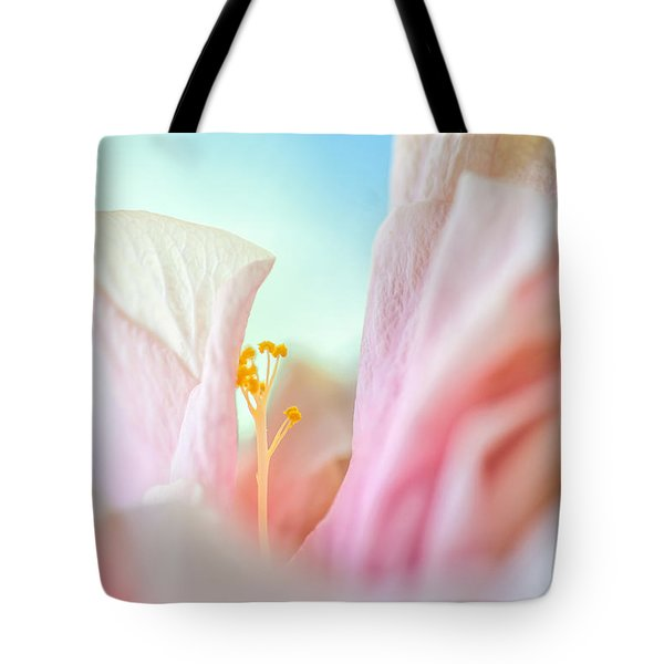 Peach Hibiscus. Macro Tote Bag by Jenny Rainbow