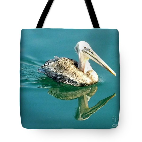 Tote Bag featuring the photograph Pelican In San Francisco Bay by Clare Bevan