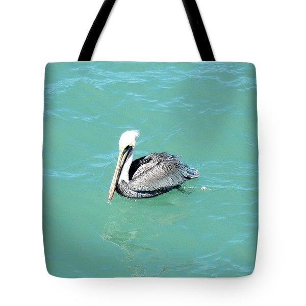 Tote Bag featuring the photograph Pelican by Oksana Semenchenko