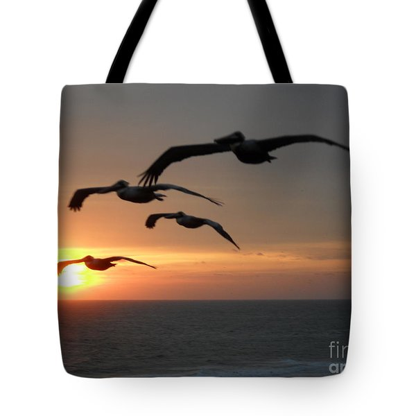 Tote Bag featuring the photograph Pelican Sun Up by Laurie L