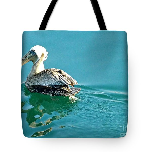 Tote Bag featuring the photograph Pelican Swimming by Clare Bevan