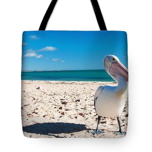 Tote Bag featuring the photograph Pelican Under Blue Sky by Yew Kwang