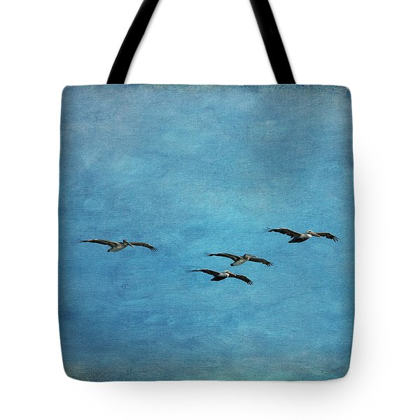 Pelicans In Flight Tote Bag