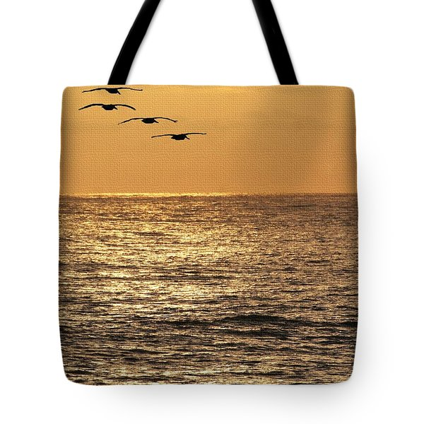 Tote Bag featuring the photograph Pelicans Ocean And Sunsetting by Tom Janca
