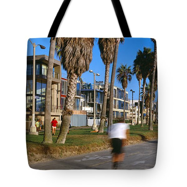 People Riding Bicycles Near A Beach Tote Bag by Panoramic Images