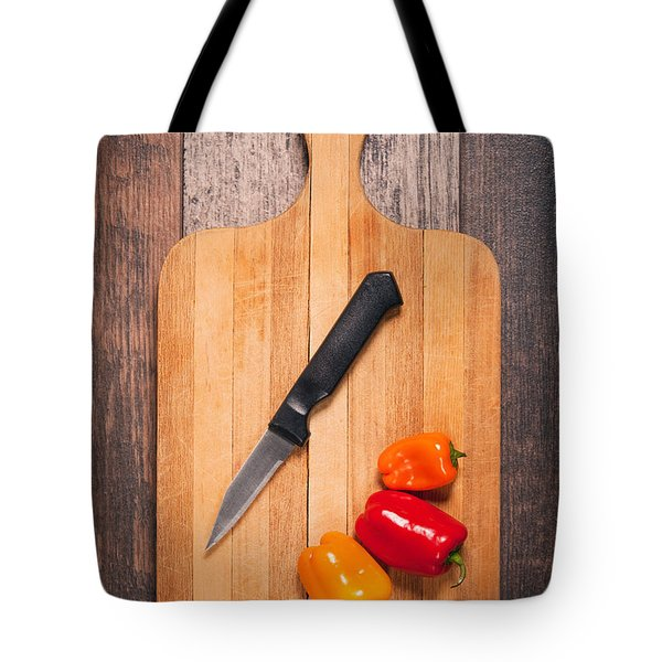Peppers And Knife On Cutting Board Tote Bag by Sharon Dominick