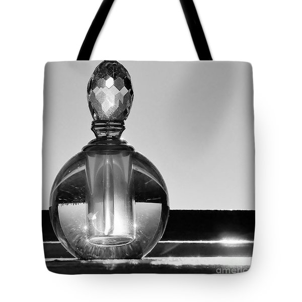 Tote Bag featuring the photograph Perfume Bottle Inversion by Lilliana Mendez
