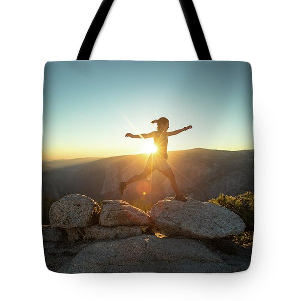 Person Leaping Along Rocks At Sunset Tote Bag