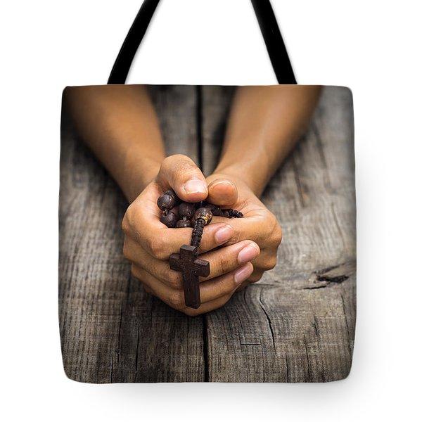 Person Praying Tote Bag