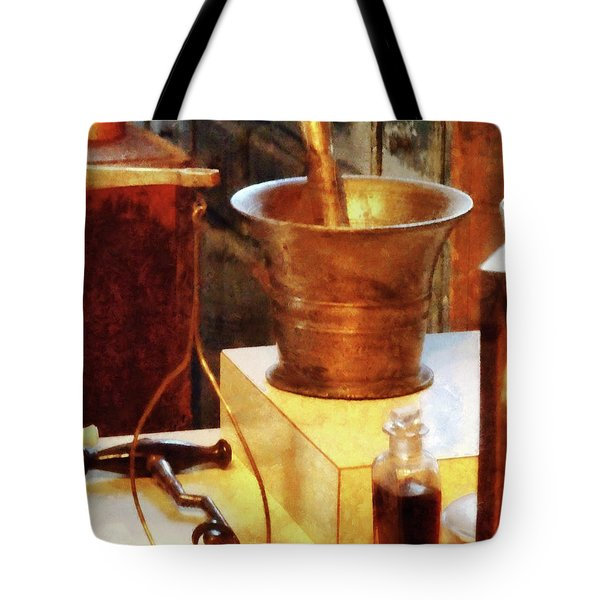 Tote Bag featuring the photograph Pharmacist - Brass Mortar And Pestle by Susan Savad