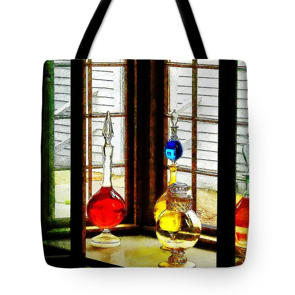 Tote Bag featuring the photograph Pharmacist - Colorful Bottles In Drug Store Window by Susan Savad