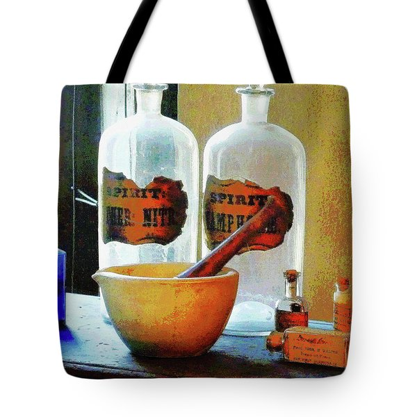 Tote Bag featuring the photograph Pharmacist - Mortar And Pestle With Bottles by Susan Savad