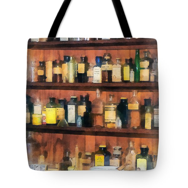 Tote Bag featuring the photograph Pharmacist - Mortar Pestles And Medicine Bottles by Susan Savad