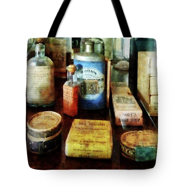 Tote Bag featuring the photograph Pharmacy - Cough Remedies And Tooth Powder by Susan Savad