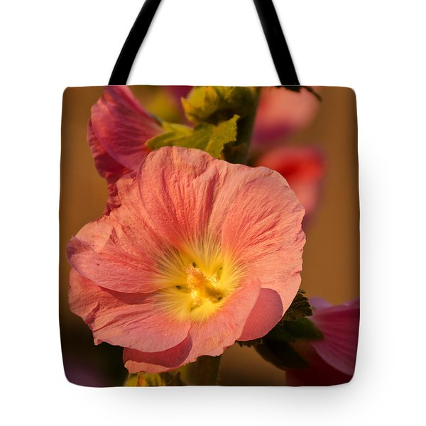 Tote Bag featuring the photograph Pink And Yellow Hollyhock by Sue Smith