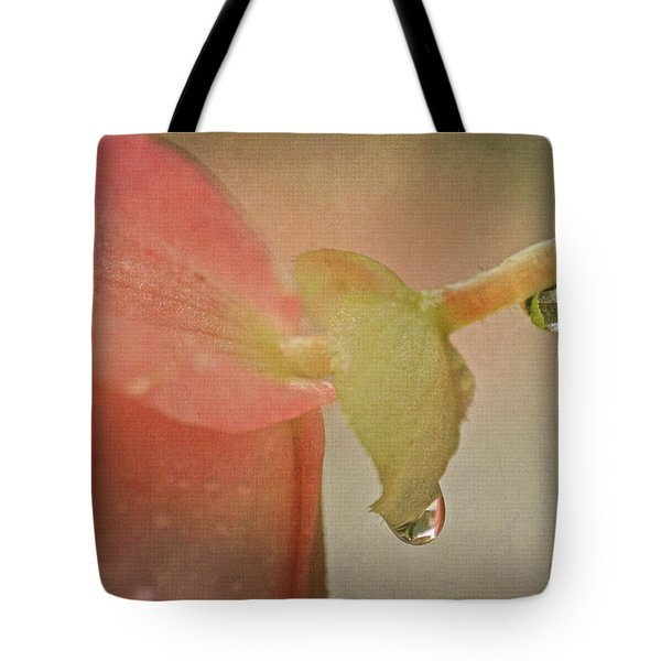 Tote Bag featuring the photograph Pink Begonia And Water Drops by Peggy Collins