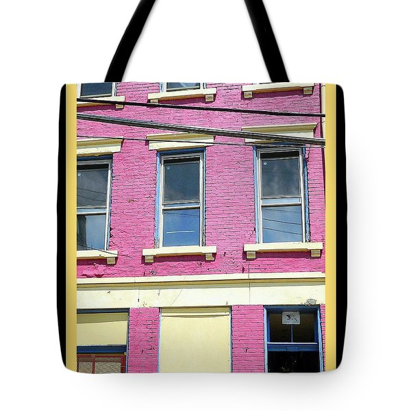 Tote Bag featuring the photograph Pink Yellow Blue Building by Kathy Barney