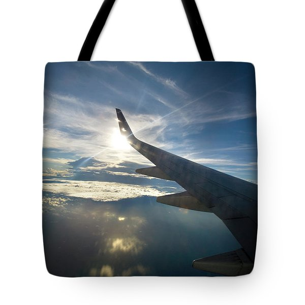 Plane Flies Over The Pacific Ocean Tote Bag