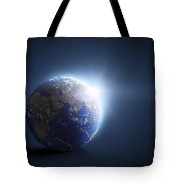 Planet Earth And Sunlight On A Dark Tote Bag by Evgeny Kuklev