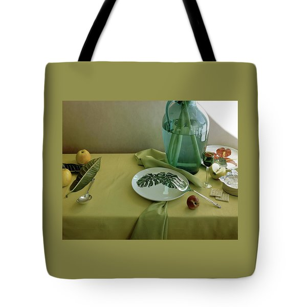 Plates, Apples And A Vase On A Green Tablecloth Tote Bag