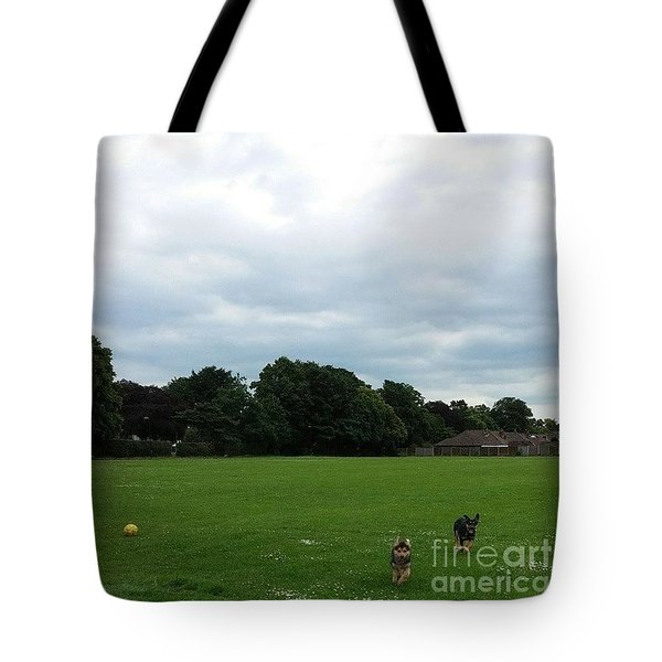 Playing Football Tote Bag