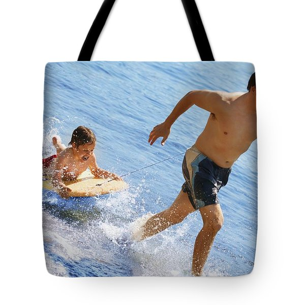 Playing In Water Tote Bag