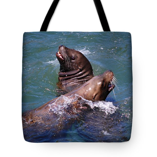 Tote Bag featuring the photograph Playing Pair Of Sea Lions by Debra Thompson