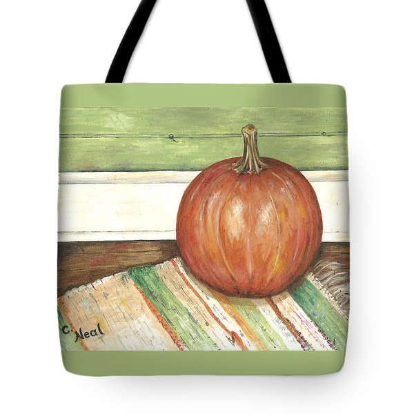 Pumpkin On A Rag Rug Tote Bag