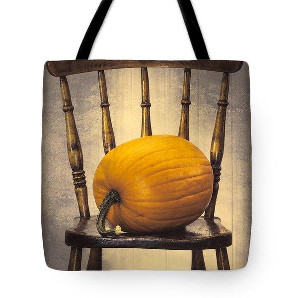Pumpkin On Chair Tote Bag by Amanda Elwell