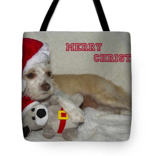 Tote Bag featuring the photograph Puppy Christmas Toy by Photography by Laura Lee