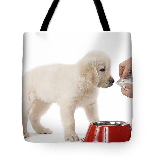 Puppy Receiving Medicine Tote Bag by Jean-Michel Labat