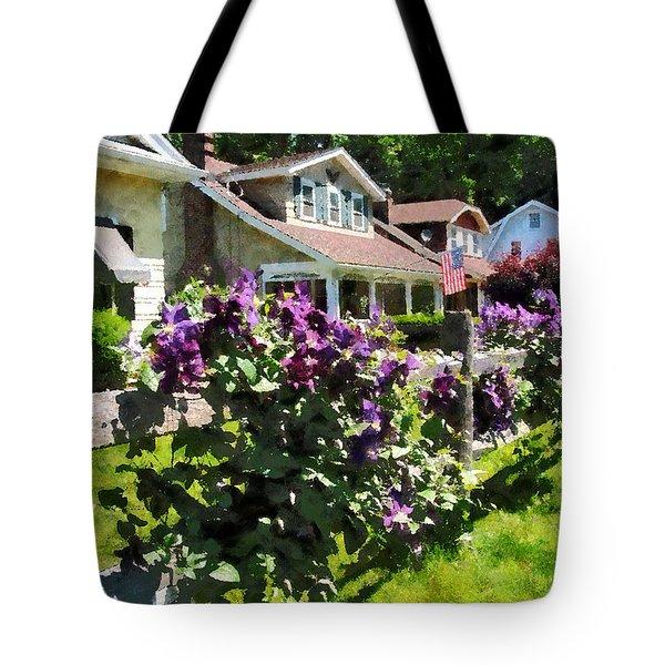 Purple Clematis On Rustic Fence Tote Bag by Susan Savad