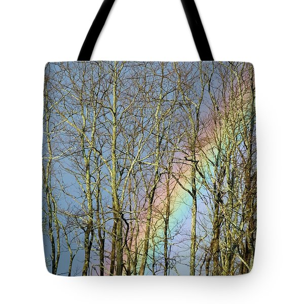 Tote Bag featuring the photograph Rainbow Hiding Behind The Trees by Kristen Fox