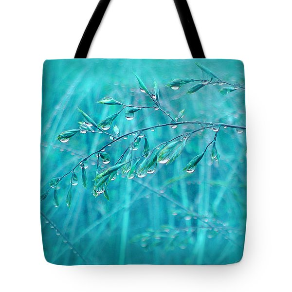 Tote Bag featuring the photograph Raindrops Falling On Teal Blue Grasses by Jennie Marie Schell