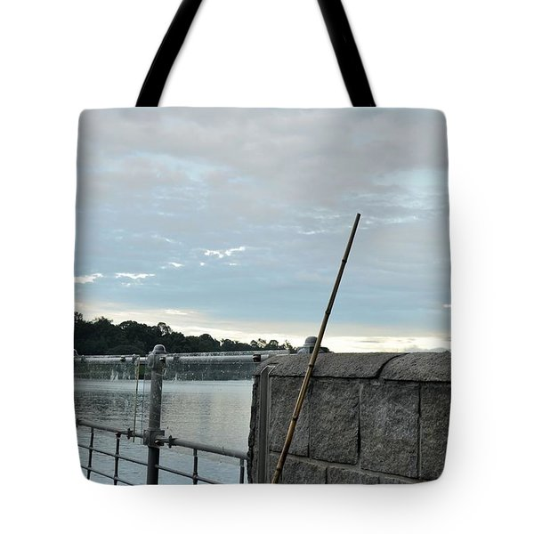Tote Bag featuring the photograph Rake Rests Itself After A Hard Days Work by Imran Ahmed