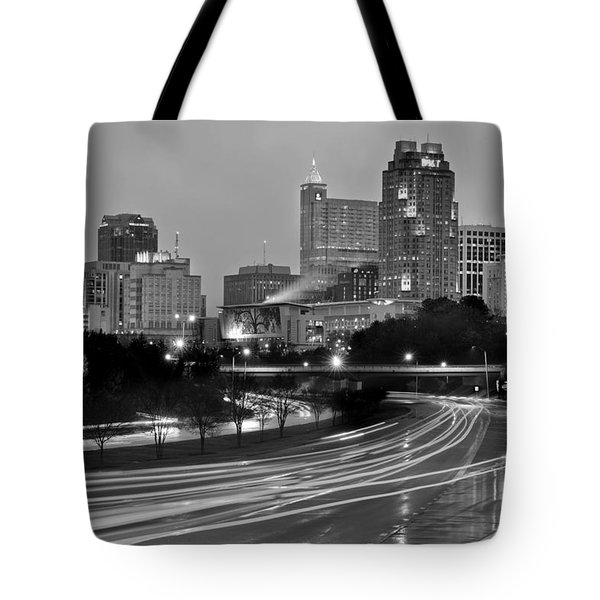 Tote Bag featuring the photograph Raleigh Skyline At Dusk Evening Black And White Bw Evening Panorama North Carolina Nc by Jon Holiday