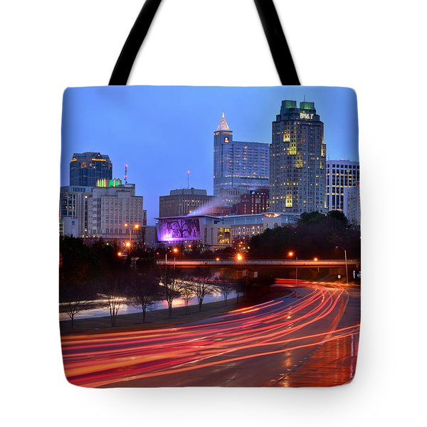 Tote Bag featuring the photograph Raleigh Skyline At Dusk Evening Color Evening Panorama North Carolina Nc by Jon Holiday