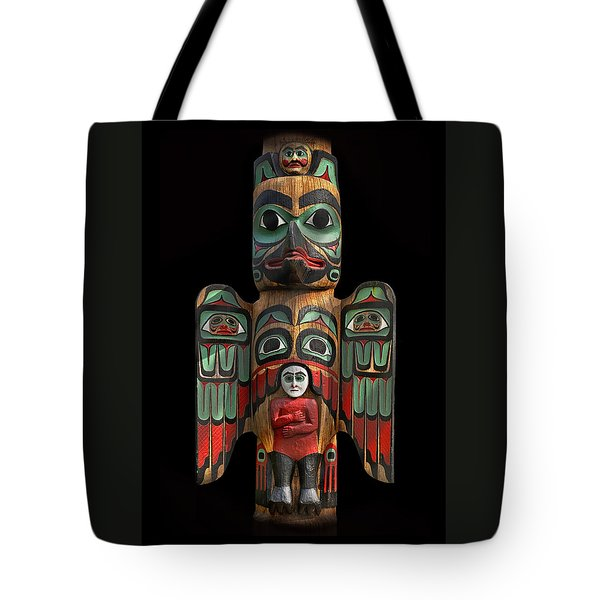 Raven And Saxman Totem Tote Bag by Gary Warnimont