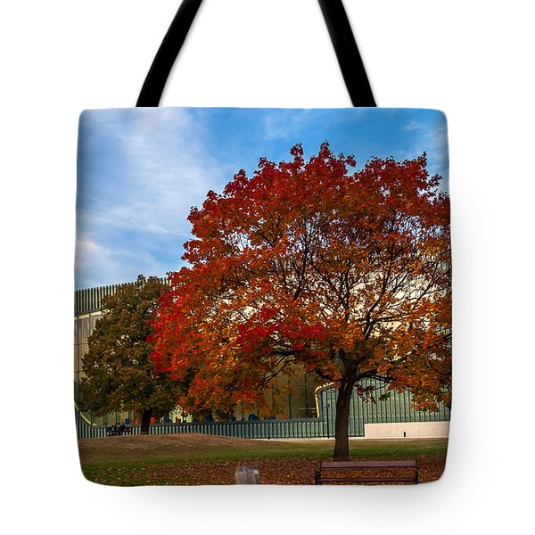 Tote Bag featuring the photograph Red And Yellow Tree At The Front Of The Museum Of The History Of Polish Jews In Warsaw by Julis Simo