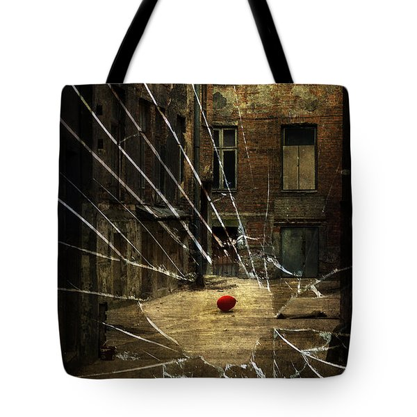 An Old Courtyard And Red Baloon On The Floor Seeing Through Broken Window Glass Tote Bag
